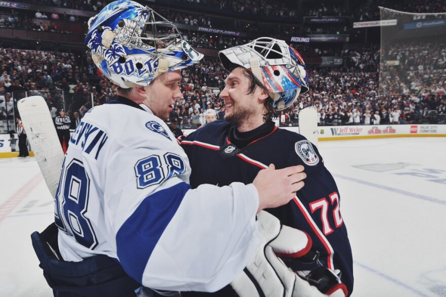 Tampa Bay Lightning goalie Andrei Vasilevskiy, left, congratulates his Columbus counterpart, Sergei Bobrovsky, after the Blue Jackets completed a four game sweep Tuesday night, 7-3.