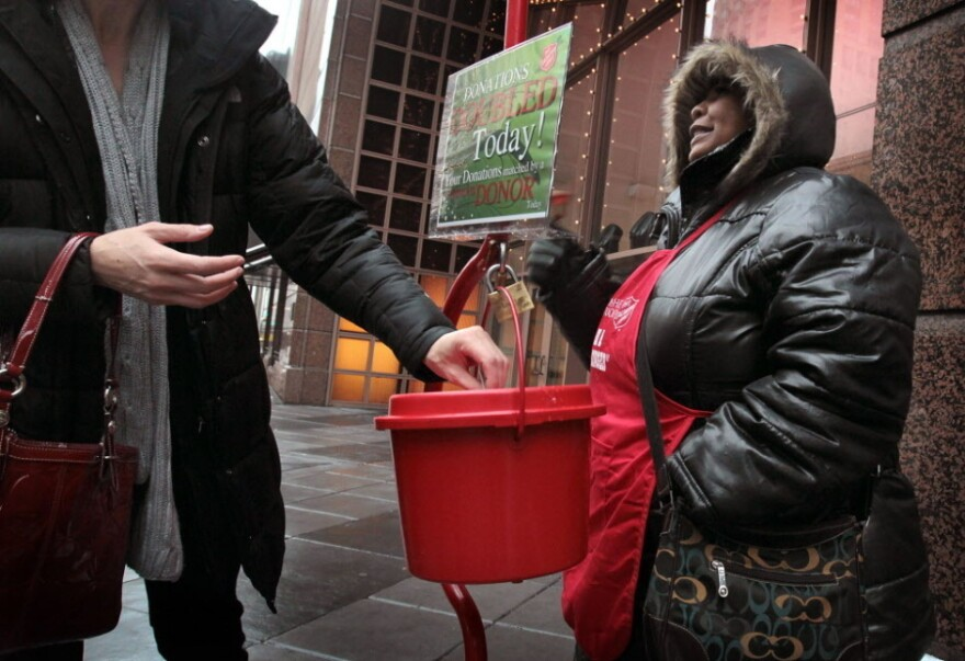 Antionette Levi solicits donations for the Salvation Army in Chicago.