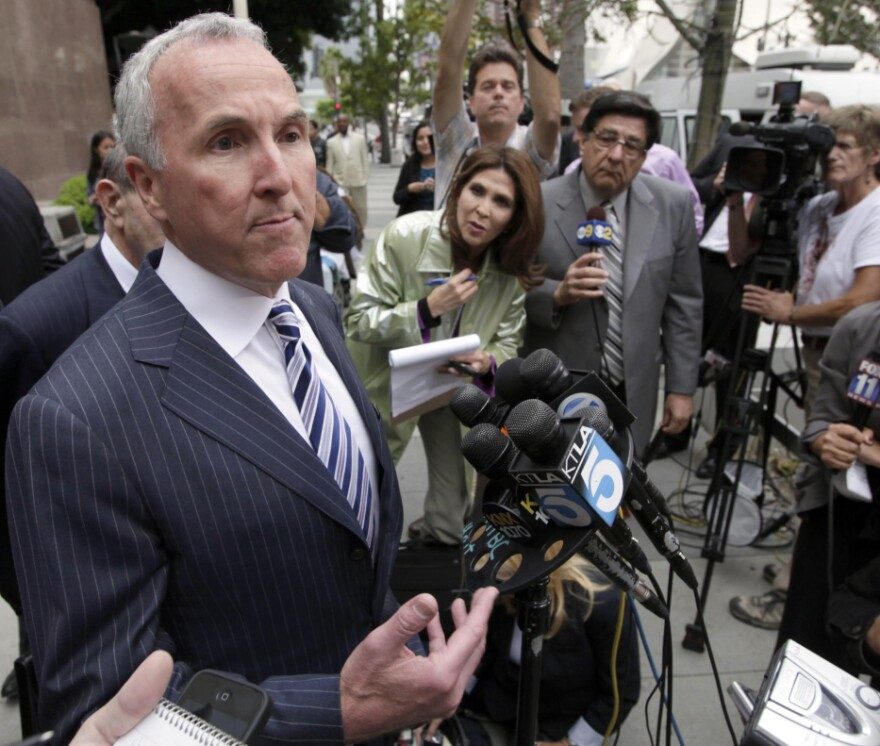Los Angeles Dodgers' owner Frank McCourt speaks to the media outside court in Los Angeles earlier this month. McCourt cited Major League Baseball Commissioner Bud Selig's interference with club operations and refusal to approve a Dodgers TV deal with Fox Sports as the cause for Monday's bankruptcy filing.