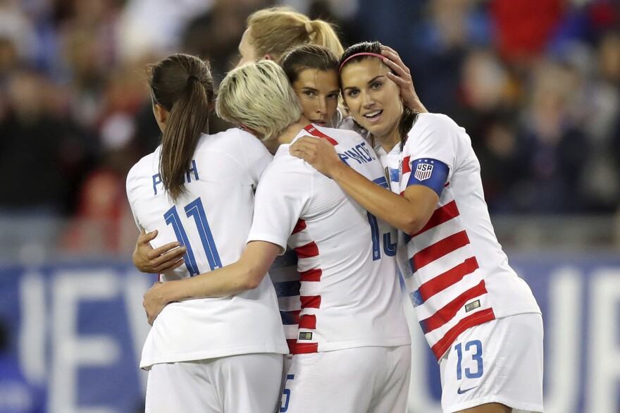 United States' Tobin Heath, second from right, is congratulated on her goal by Mallory Pugh (11), Megan Rapinoe and Alex Morgan (13) during the first half of a SheBelieves Cup soccer match against Brazil in Tampa, Fla., March 5, 2019. (Mike Carlson, File/AP)
