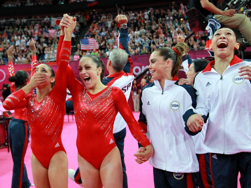 Alexandra Raisman, Jordyn Wieber, Mc Kayla Maroney and Kyla Ross (left-right) of the  U.S. women's gymnastics team celebrate their gold medal.