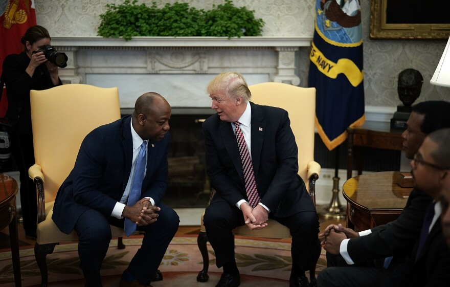 President Trump speaks to Sen. Tim Scott, R-S.C., during a working session on opportunity zones in the Oval Office in February 2018.