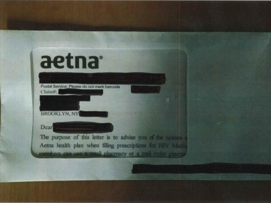 A photo provided by the AIDS Law Project of Pennsylvania shows an Aetna mailer in which a reference to HIV medication is partly visible though the envelope window.