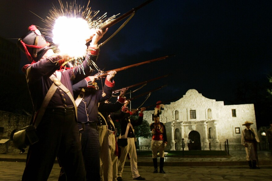 Members of the San Antonio Living History Association fire a volley as they take part in a Dawn at the Alamo memorial service at Alamo Plaza in San Antonio on March 6, 2006. Texas is taking back the landmark from the Daughters of the Republic of Texas, which has run the Alamo for more than 100 years.