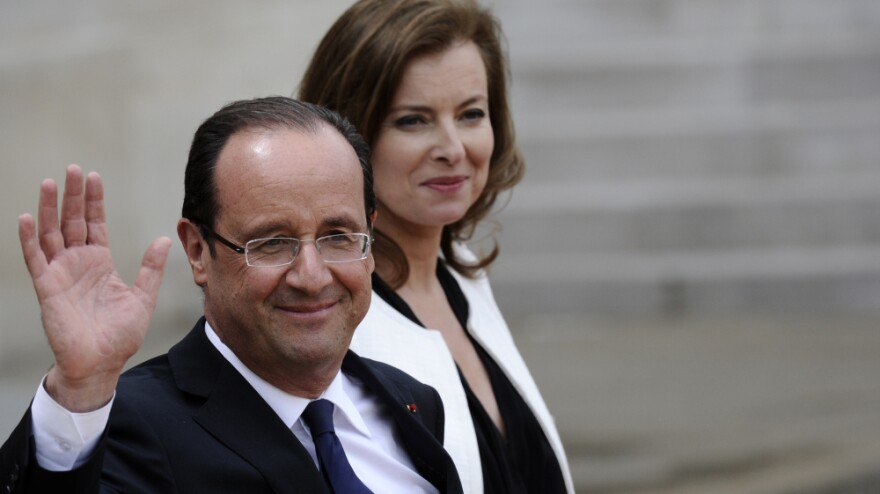 Newly installed French President Francois Hollande and his partner, Valerie Trierweiler, leave the presidential Elysee Palace in Paris after a formal handover ceremony Tuesday.