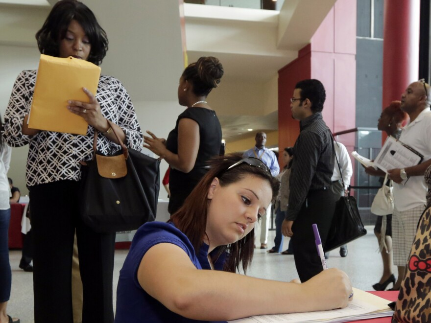 Jessica Pimentel fills out an application during a job fair in Sunrise, Fla. The latest employment numbers indicate a slowdown in job growth, but many economists are skeptical that the economy is weakening.