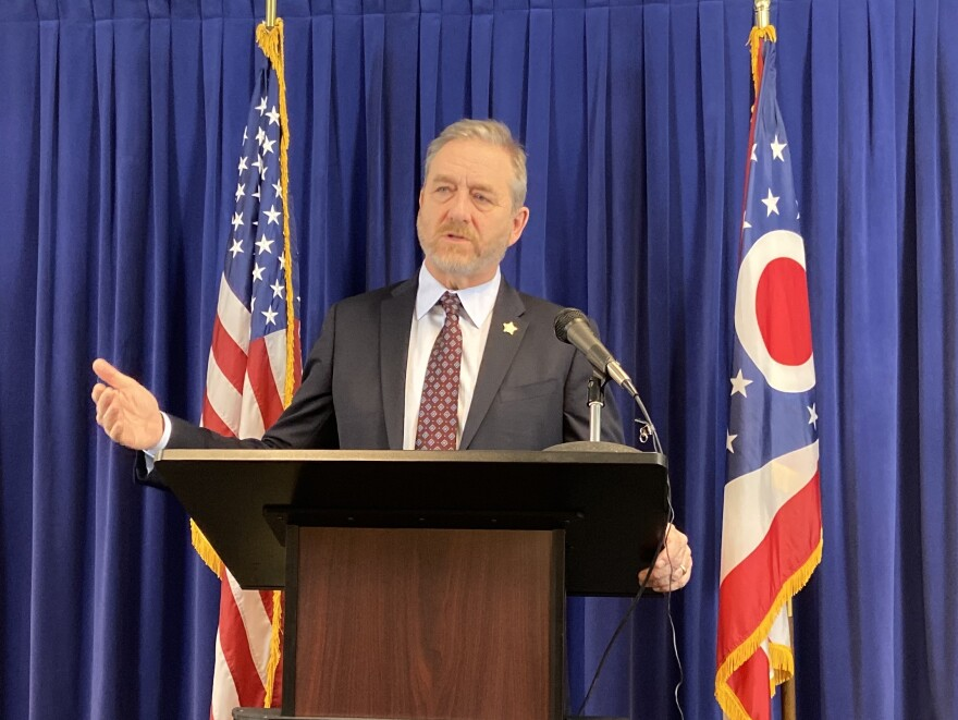 Attorney General Dave Yost gestures at a news conference last month.
