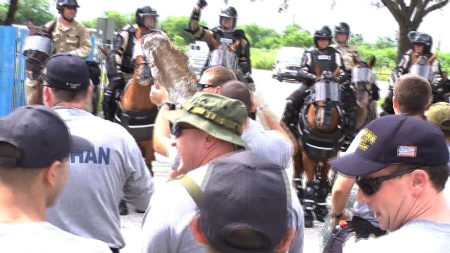 horsies and protesters.jpg
