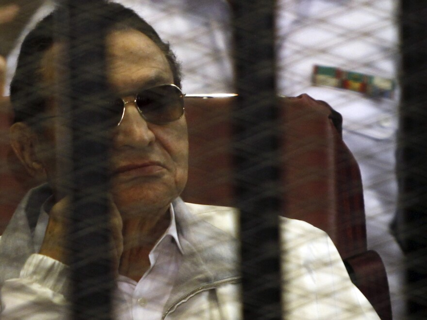 Former Egyptian President Hosni Mubarak sits in the dock during a June 8 court hearing in Cairo.