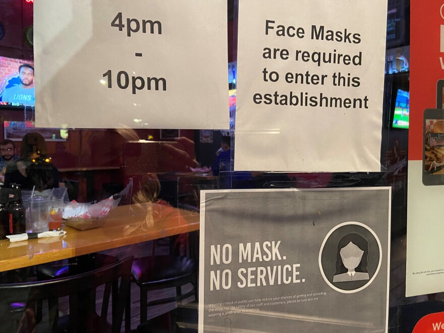 Signs for state's fask mask requirement at bar in Cleveland