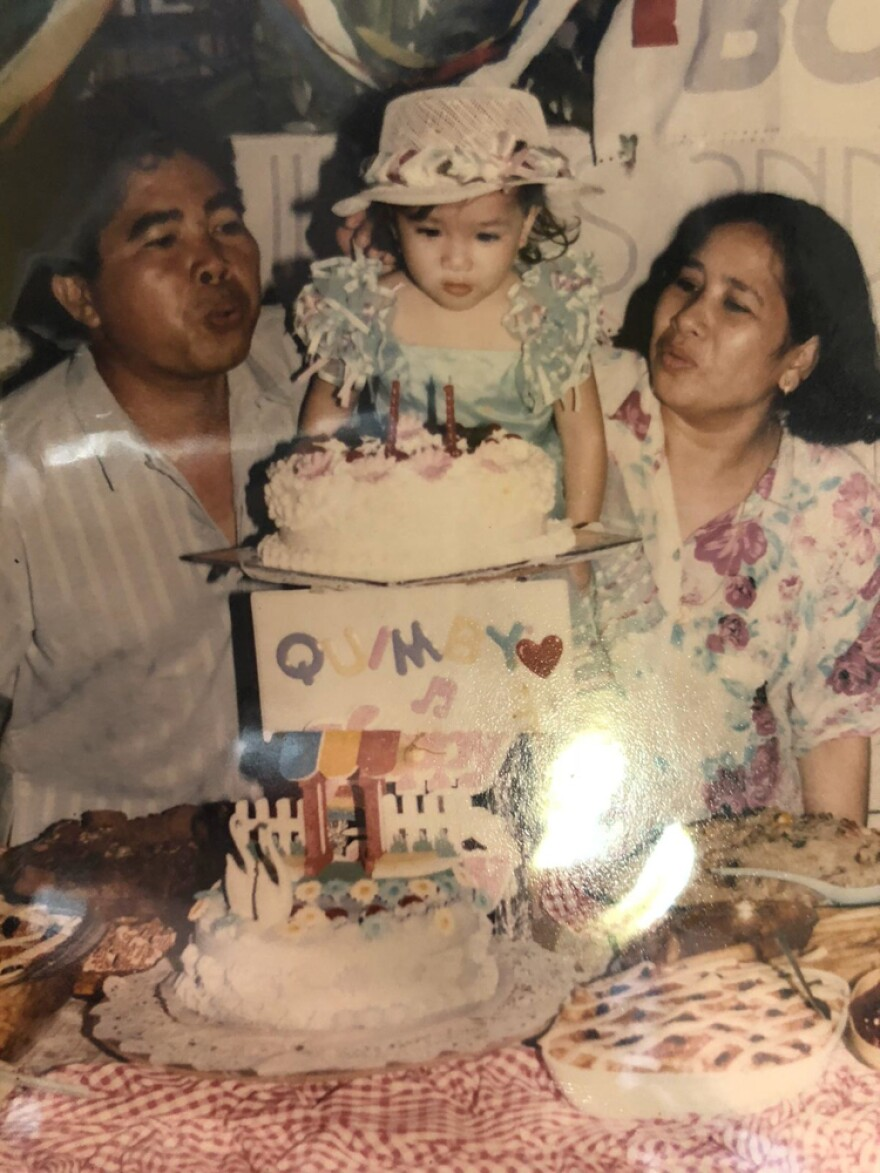 A childhood photo of Kym Villamer celebrating her first birthday with her parents, Baldomero and Bernadette Villamer, in their home in Iriga City, Philippines.