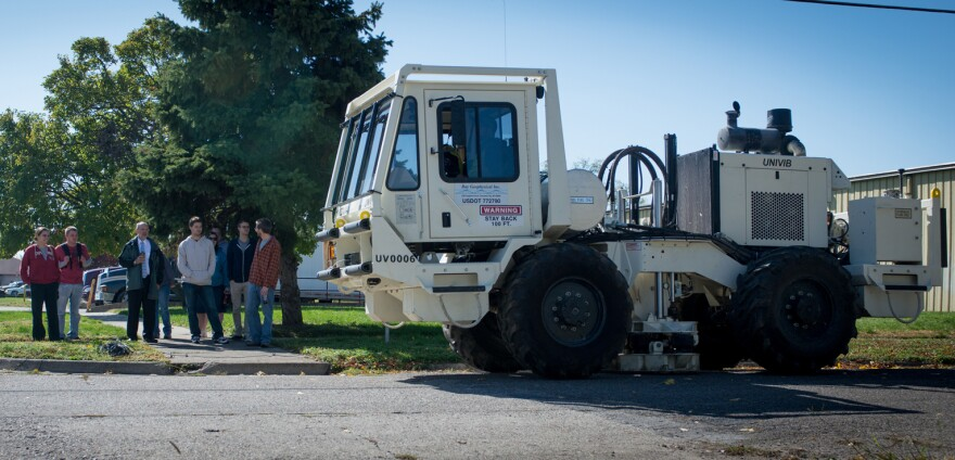 Students in environmental science professor Jeffery Stone's class watch as a seismic shaker truck rolls through Indiana State University's campus.