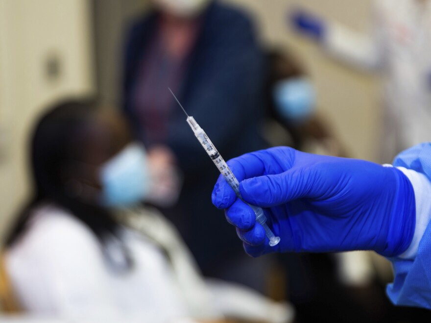 A doctor prepares to administer a vaccine injection at NewYork-Presbyterian Lawrence Hospital on Friday in Bronxville, N.Y.