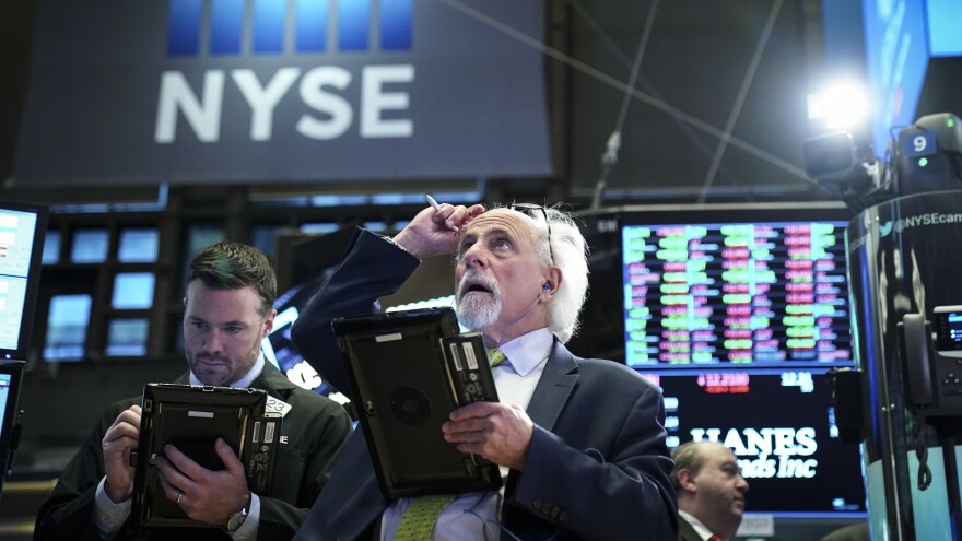 Traders and financial professionals work on the floor of the New York Stock Exchange after yet another bout of recent stock market volatility.
