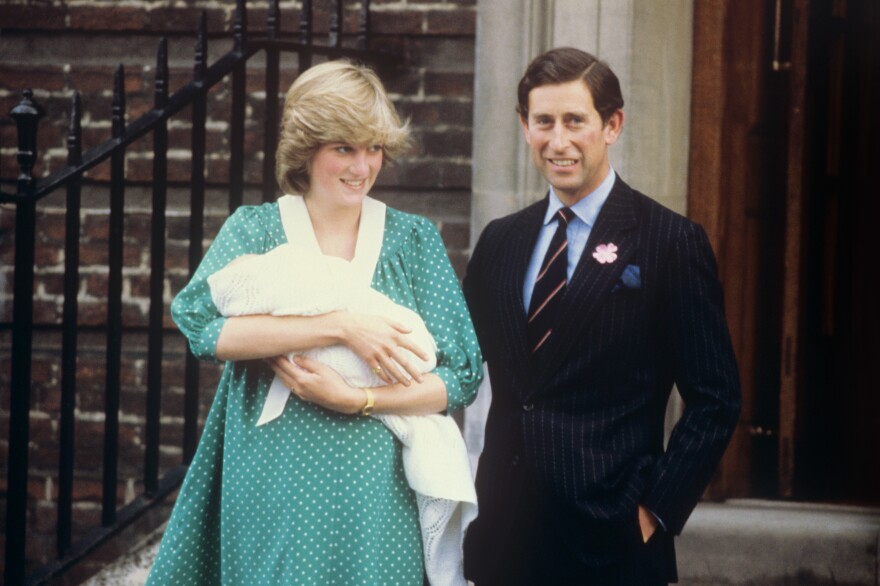 Prince Charles and Diana, Princess of Wales, pose outside the Lindo Wing of St. Mary's Hospital in London with their firstborn son, Prince William, in 1982.