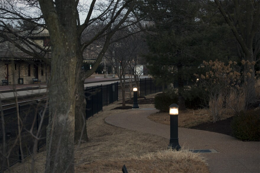Lights illuminate commemorative plaques along a walkway behind Kirkwood City Hall. Feb. 6, 2018