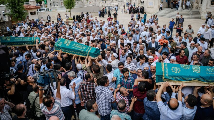 People carry the coffins of Meryem Amiri, Karime Amiri, Zehra Amiri and Huda Amiri during their funerals on Thursday, two days after they were killed by a suicide bombing and gun attack that targeted Istanbul's Ataturk airport.