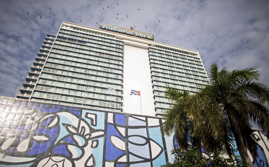 Huge cell towers top Havana's Habana Libre luxury hotel, and locals gather nearby to take advantage of the Internet access.