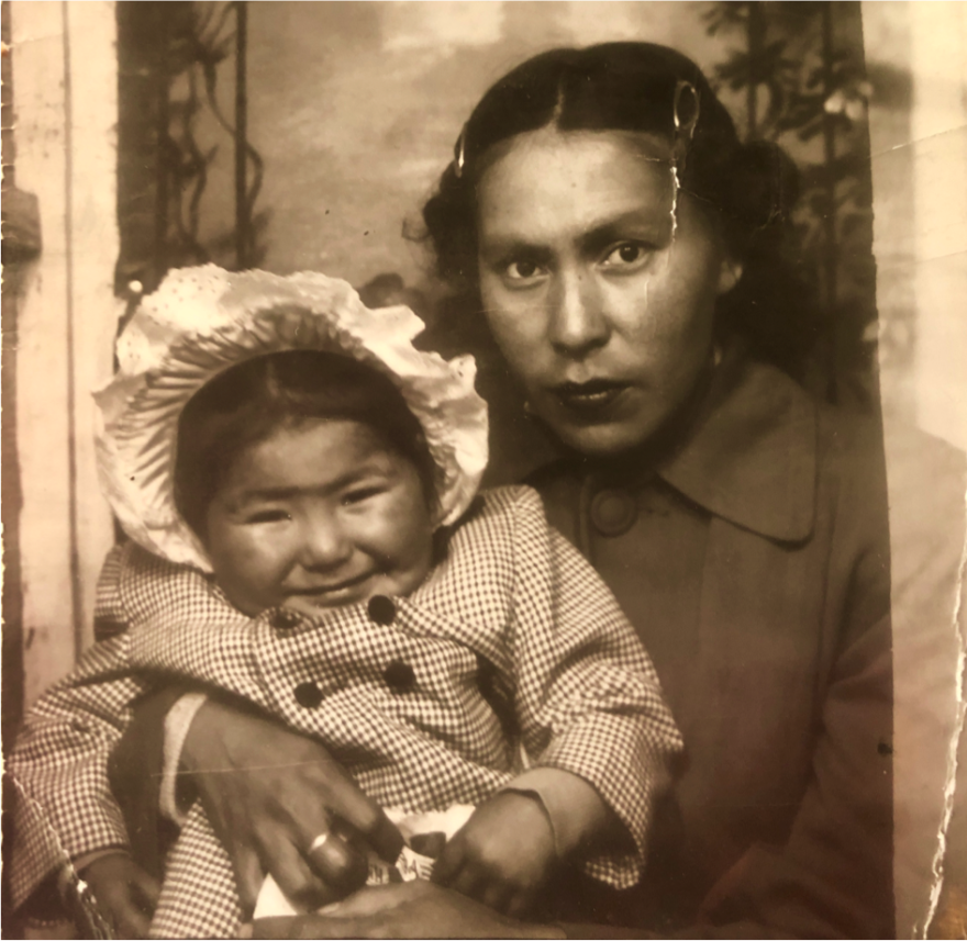 A photo taken in 1953 shows Corey Gray's mother, Sharon Yellowfly, held by her mother, Cecile Yellowfly.