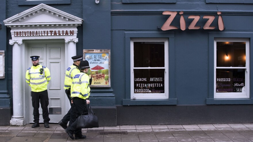 """Police outside an Italian restaurant in Salisbury, England, on Tuesday, near to where former Russian spy double agent Sergei Skripal and his adult daughter were found critically ill Sunday following exposure to an """"unknown substance."""""""
