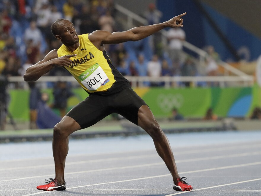 Usain Bolt from Jamaica celebrates winning the gold medal in the men's 200-meter final during the athletics competitions of the 2016 Summer Olympics at the Olympic stadium in Rio de Janeiro, Brazil.