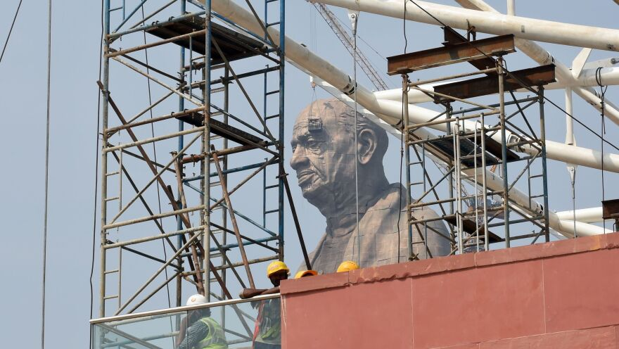 The Statue of Unity, seen earlier this month through a cluster of construction equipment.