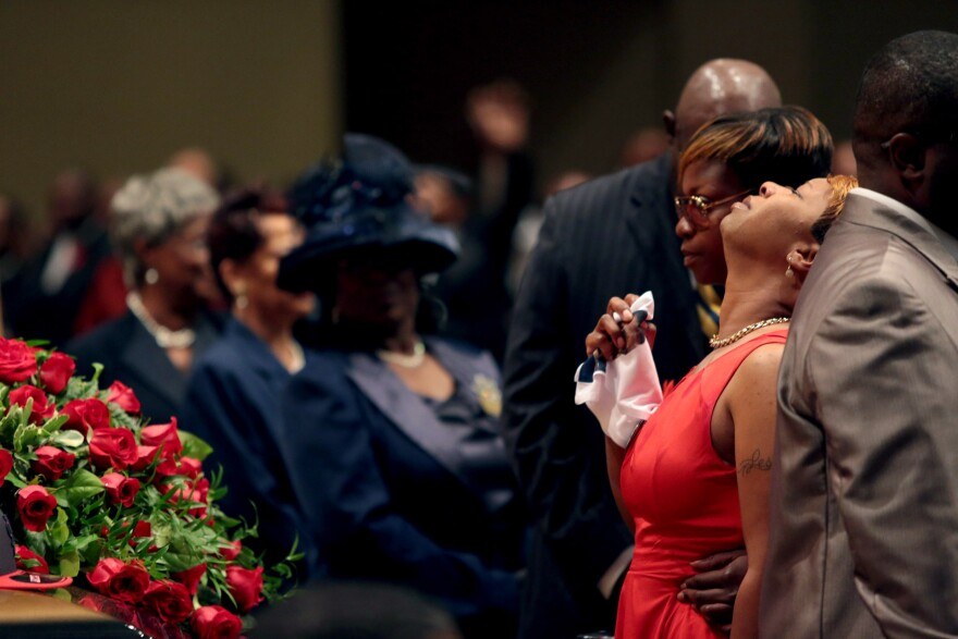Lesley McSpadden is comforted during the funeral services for her son Michael Brown inside Friendly Temple Missionary Baptist Church in St. Louis, Mo., on Monday.