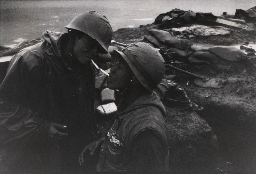 Duncan's photos often focused on the daily struggles of soldiers. Here, one American lights the cigarette of another in Con Thien, Vietnam, 1967.
