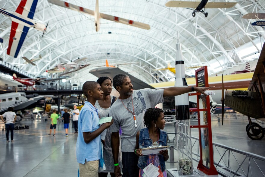 "The Brown family (left to right) Malachi, 12; Lisa Nelson-Brown; Will; and Maiyah, 7, ""go on a scavenger hunt at the museum sleepover."
