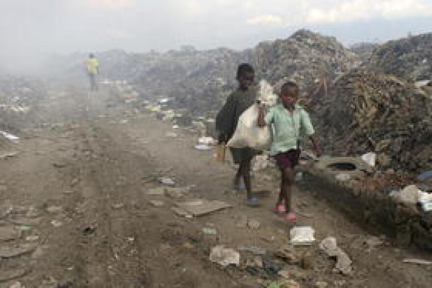 Children scavenge in a garbage dump in the Haitian capital of Port-au-Prince.