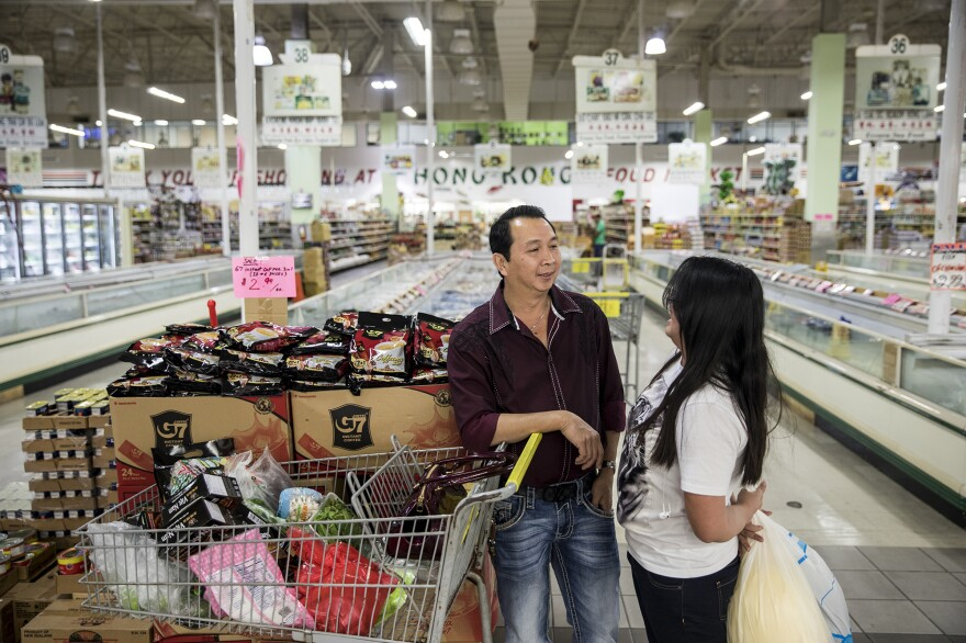 Kim Nguyen shops with his daughter Kimmy, 17, at a huge Asian supermarket in Houston.