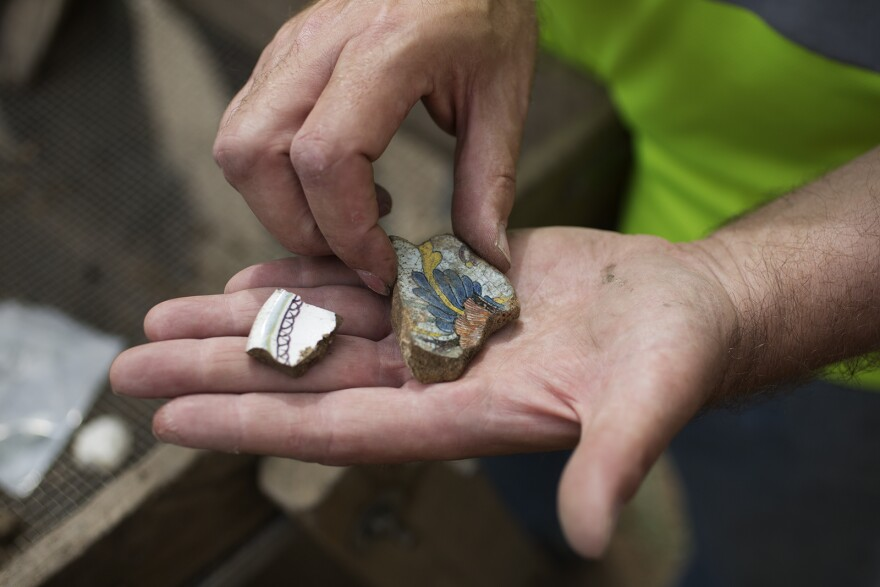 Archaeologist Michael Meyer shows off a piece of French faïence his team unearthed.