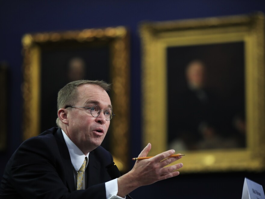 """Mick Mulvaney, acting director of the CFPB, testifies at a House hearing. Mulvaney says he doesn't need to run """"a Yelp for financial services sponsored by the federal government."""""""