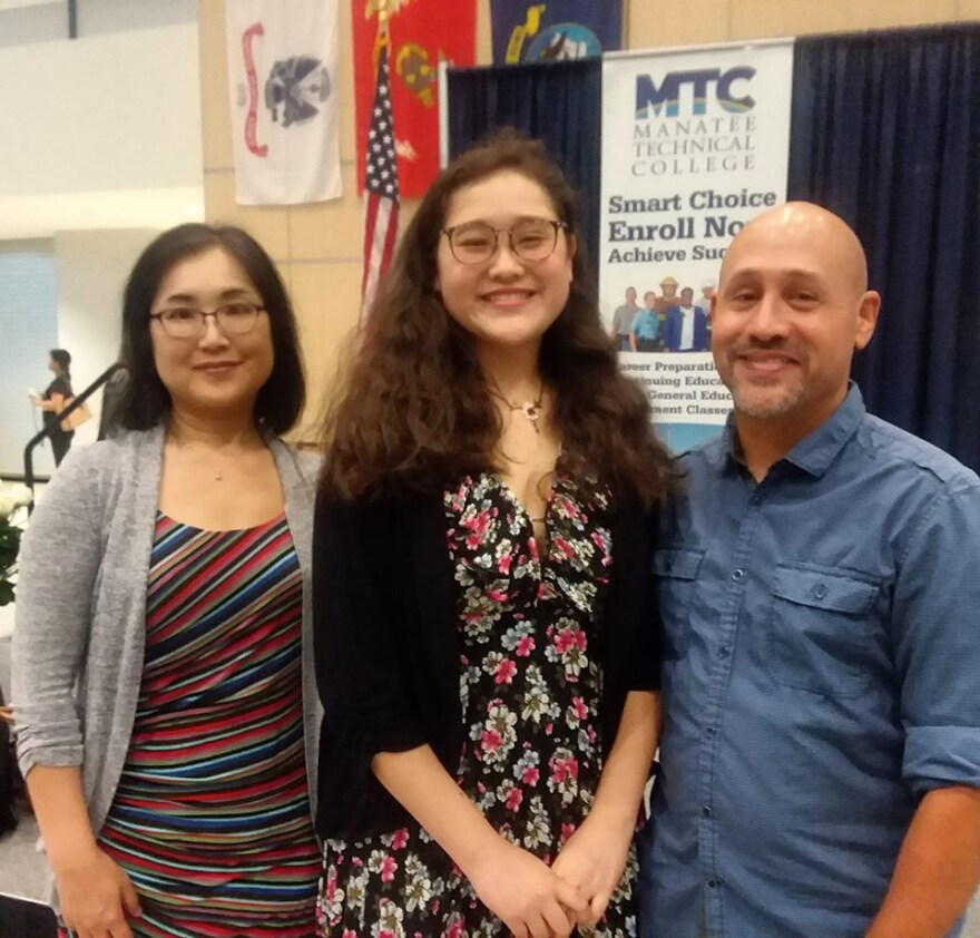 "Mina Quesen, with her parents, calls her experience with the Future Leaders Academy ""life changing.""  She heads to Princeton this fall."