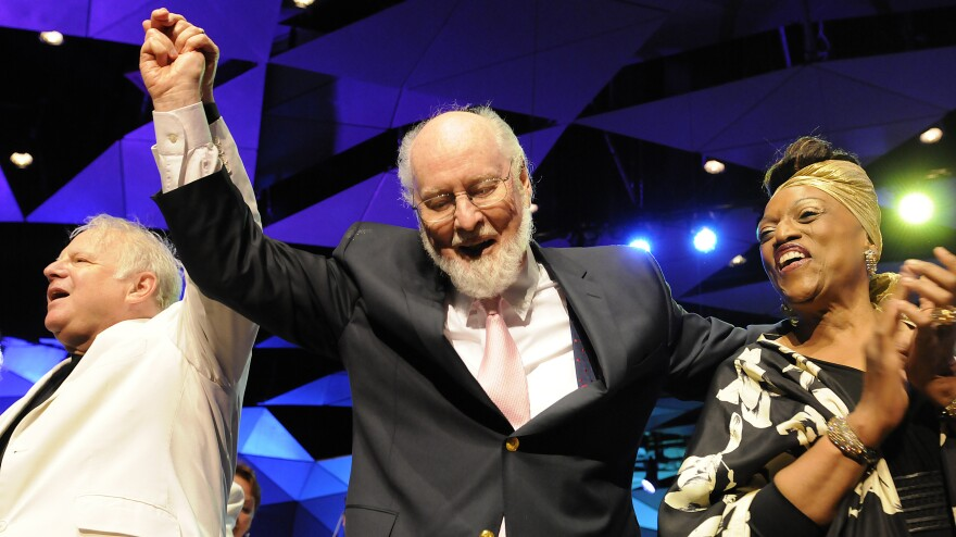 Flanked by composer Leonard Slatkin and soprano Jessye Norman, John Williams takes a bow during his 80th-birthday celebration at Tanglewood in August.