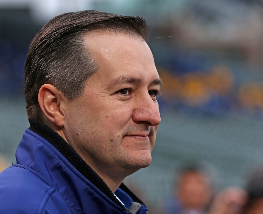 Owner Tom Ricketts of the Chicago Cubs talks with reporters before the home opener against the Philadelphia Phillies at Wrigley Field on April 4, 2014.