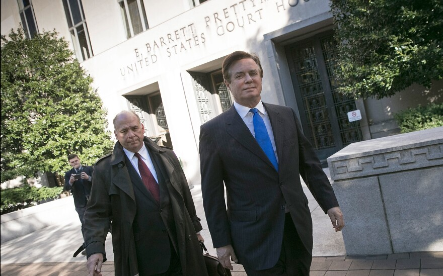 "Former Trump campaign chairman Paul Manafort (right), leaves U.S. District Court after pleading not guilty to federal charges, including ""conspiracy against the United States,"" on Monday in Washington, D.C."