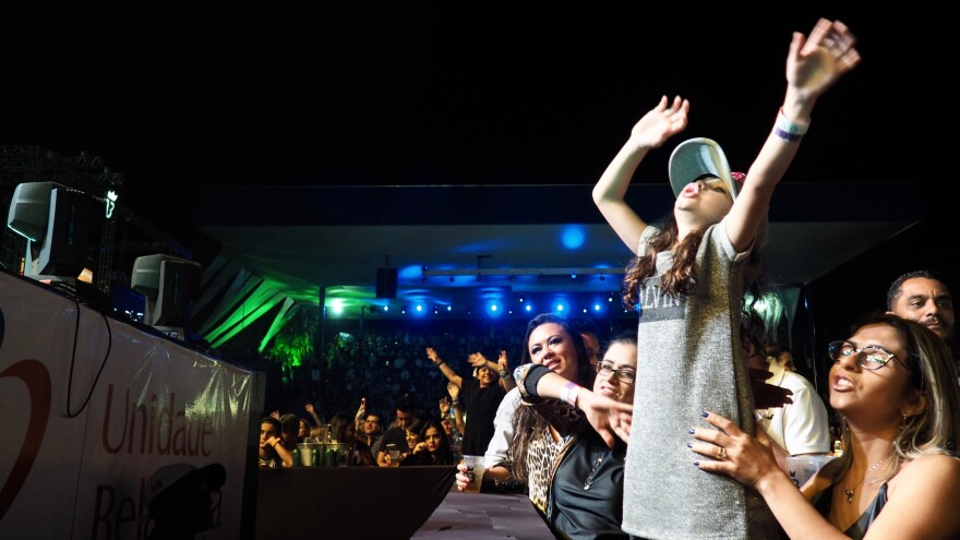 Fans of all ages — especially women — sing along at Marília Mendonça's Expo Londrina concert.