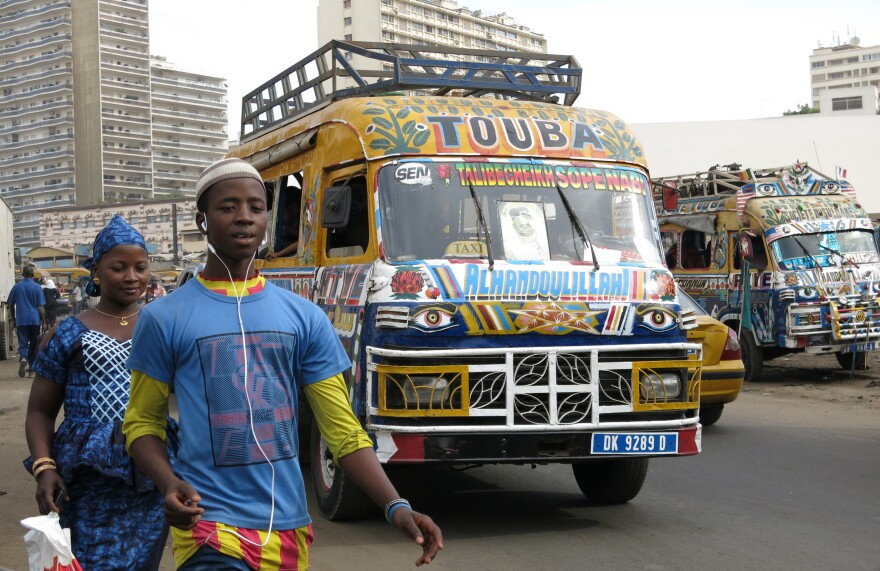 """For 50 years, the fast and cheap """"car rapide"""" minibus, painted from stem to stern, has become a national symbol for Senegal."""