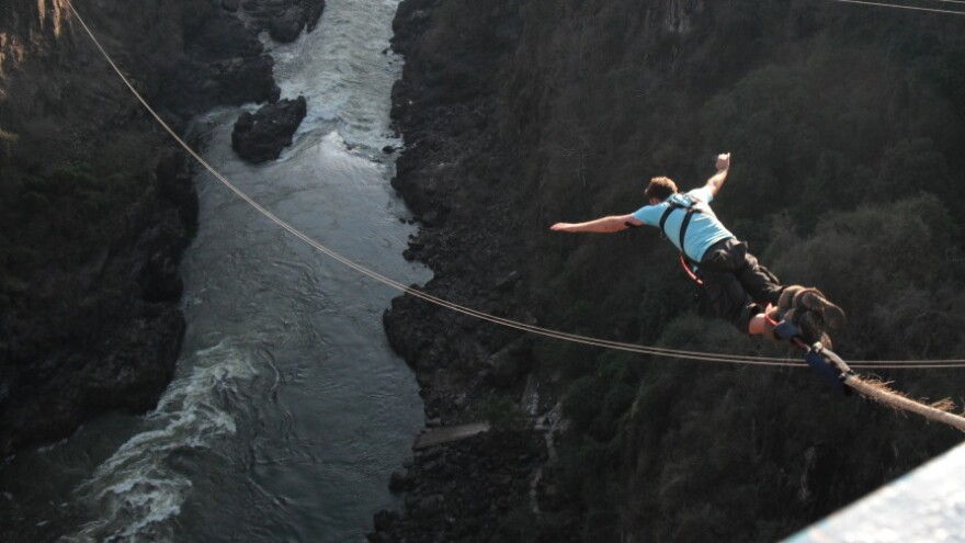 """Here goes nothing. A big jump over the <a href=""""http://www.afrizim.com/activities/victoria_falls/Bungee.asp"""">Zambezi River</a> in Africa."""