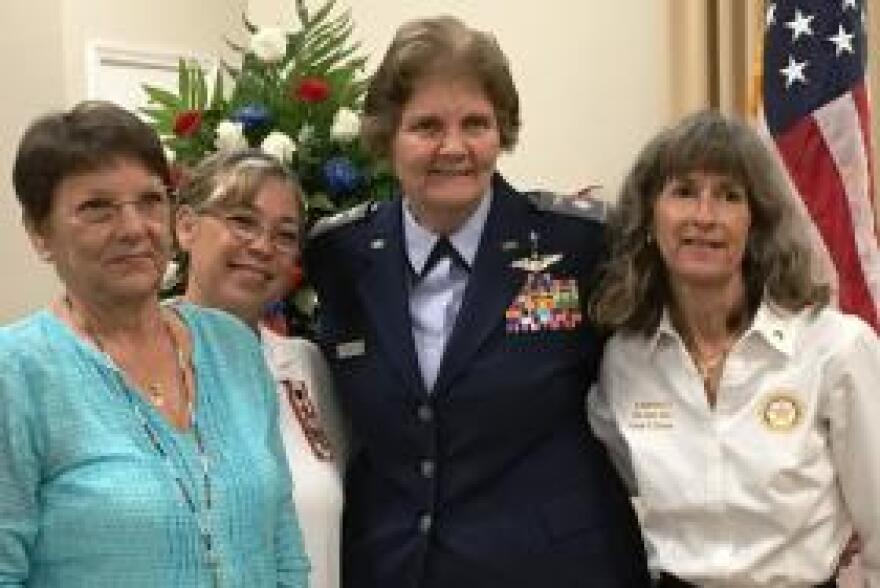 Cathy Sprigg, left, poses with Yolanda Mercado, Air Force Chaplain Linda Pugsley, and Toni Gross. Sprigg, Mercado and Gross all are mothers of fallen service members.
