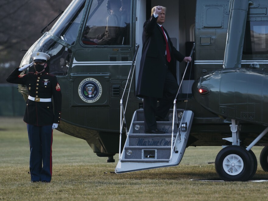 President Trump and first lady Melania Trump board Marine One as they depart the White House on Wednesday. The Trumps did not attend the inauguration of President-elect Joe Biden and Vice President-elect Kamala Harris.