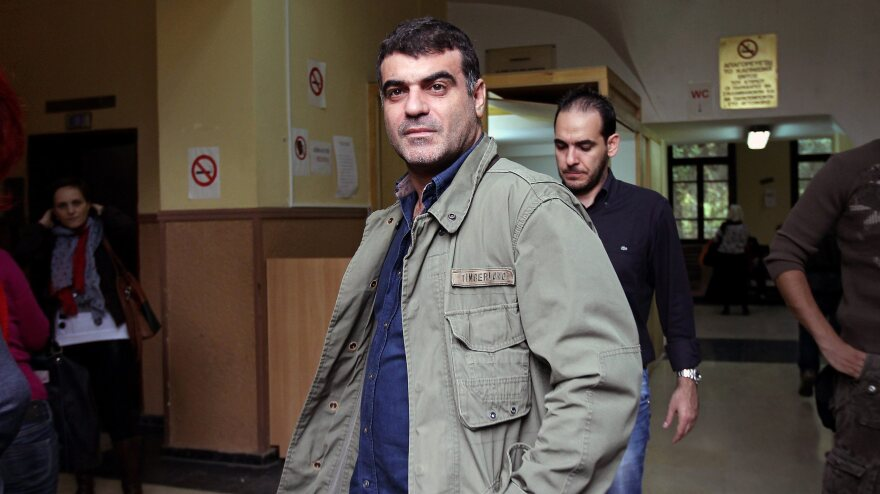 Journalist Kostas Vaxevanis waits to appear in court in Athens on Monday. Vaxevanis was arrested for the publication of 2,059 names of people alleged to have accounts in a Swiss bank.