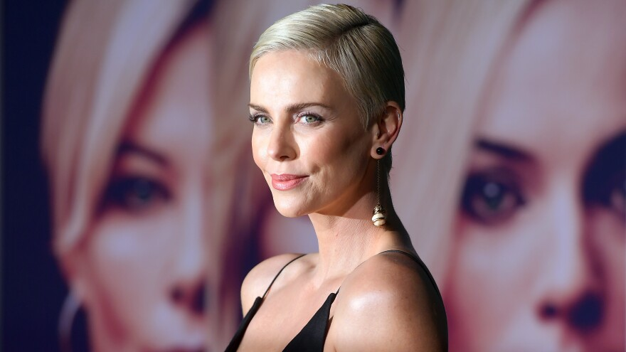 "Charlize Theron attends a screening of <em>Bombshell</em> in early December. Theron, who also produced the film, says she wanted to portray the ""nuance"" of sexual harassment: ""It's not black and white,"" she says."