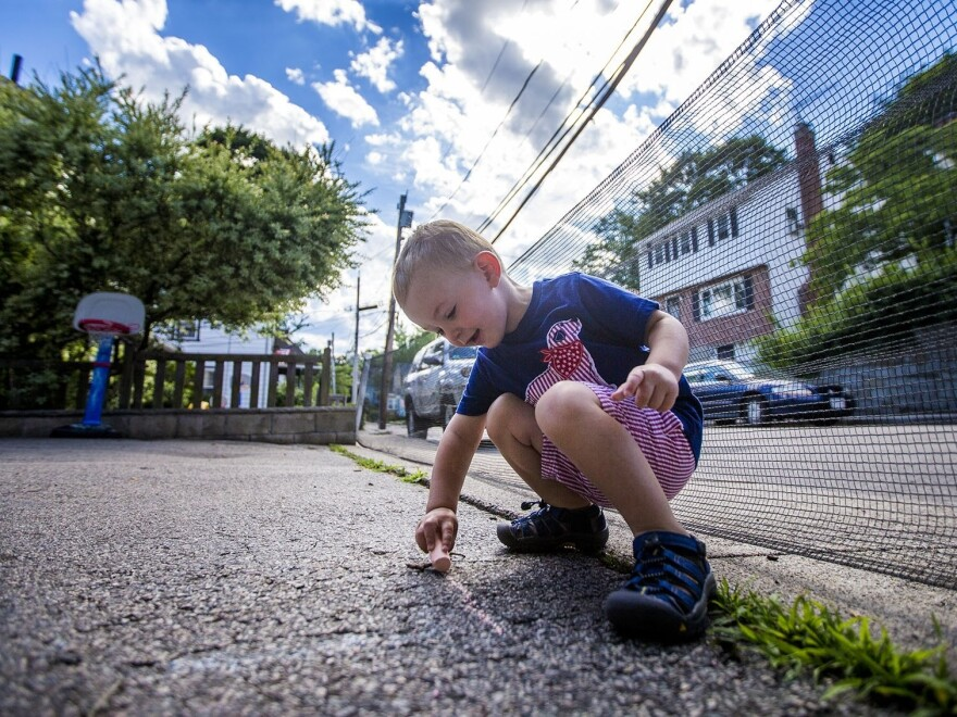 Two-year-old Robbie Klein of West Roxbury, Mass., has hemophilia, a medical condition that interferes with his blood's ability to clot normally. His parents, both teachers, worry that his condition could make it hard for them to get insurance to cover his expensive medications if the law changes.