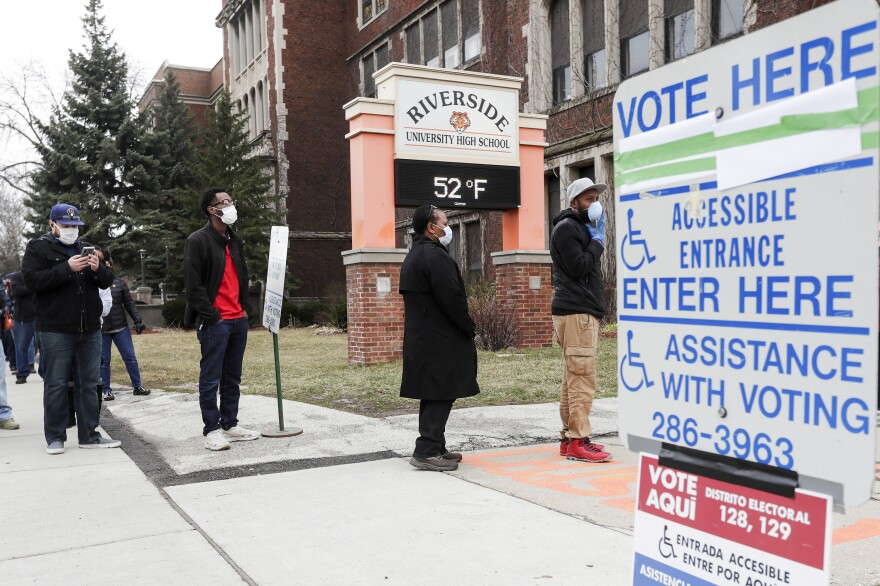 Voters line up at Riverside High School in Milwaukee for Wisconsin's primary election on Tuesday. Polling places were consolidated and altered to accommodate voting in the state's presidential primaries and other local elections Tuesday.