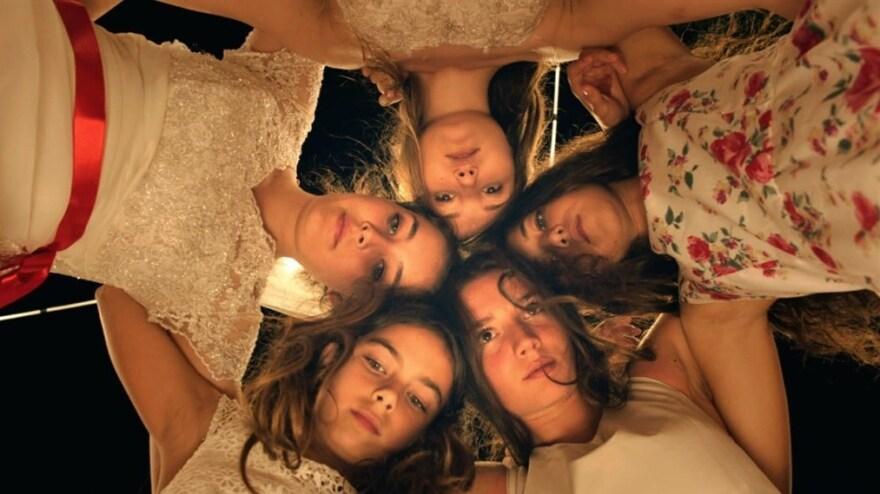 Tugba Sunguroglu, Ilayda Akdogan, Doga Zeynep Doguslu, Elit Iscan and Günes Sensoy play five orphaned teen sisters who live with their grandmother in the film <em>Mustang</em>.