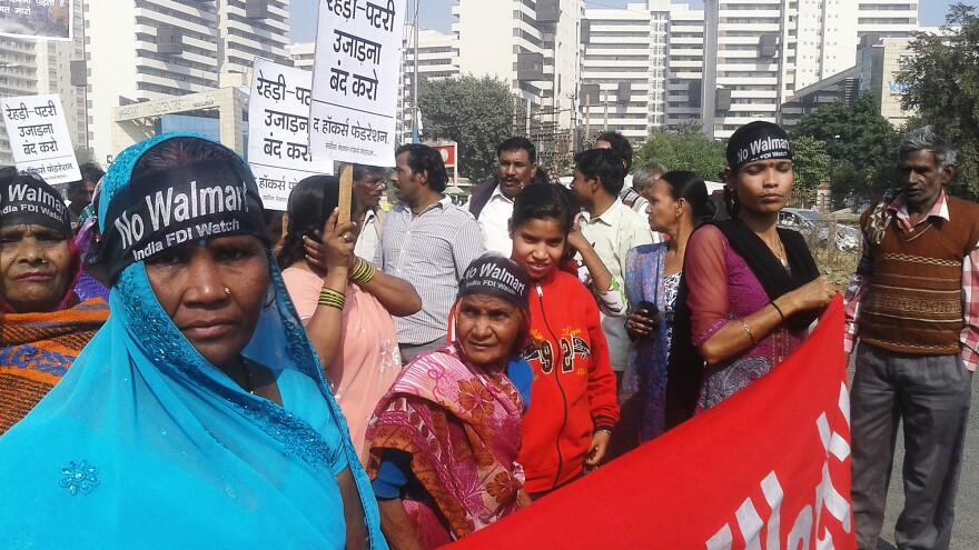 Protesters gather outside Wal-Mart's offices in Gurgaon, India. Their demand: Wal-Mart should build its stores far from markets where they work.