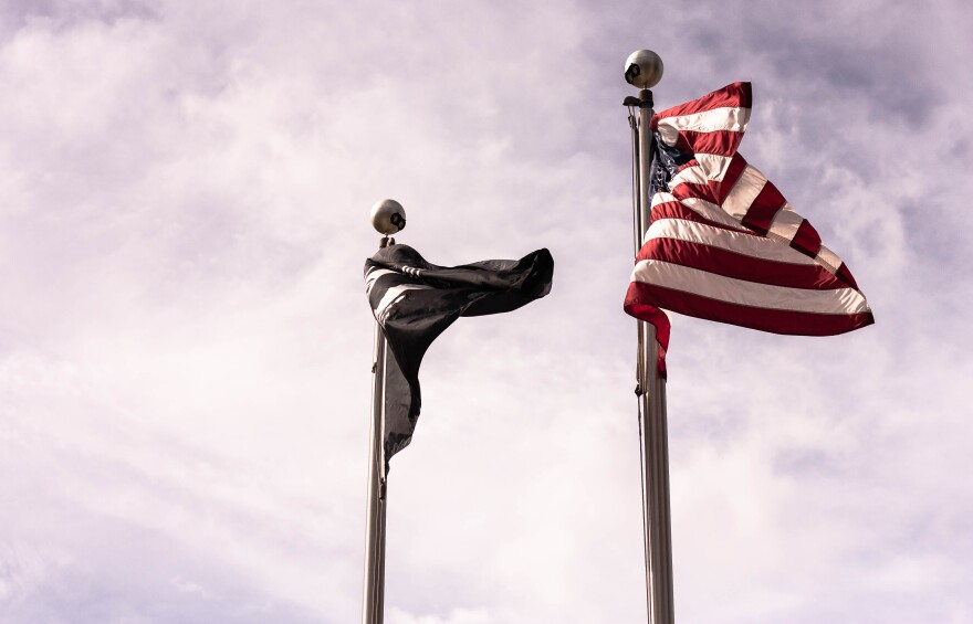 The United States and POW flags fly above the Veterans Memorial Park and Museum in Tampa.