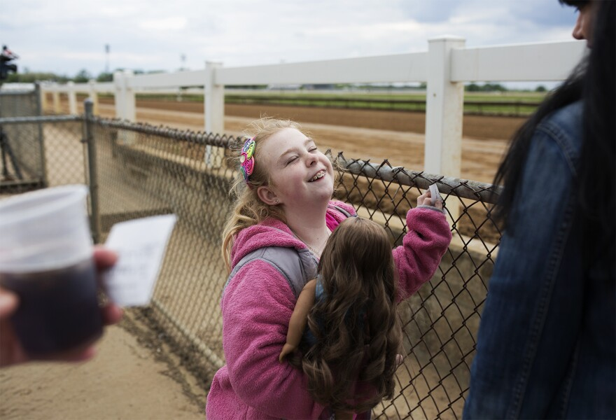 Ryleigh McMillen, 11, took the day off from school to watch the races.